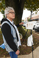 NWA Democrat-Gazette/FLIP PUTTHOFF <br />ARTIST'S EYE<br />Kay Pickett, with Plein Air Painters of the Ozarks, studies Wednesday Oct. 10 2018 the architecture of downtown Rogers while painting pictures of downtown buildings along South First Street. The group of artists meets and paints at various locations in the region each Wednesday.