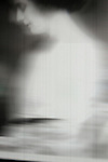 A blurred image of a woman