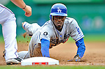 8 September 2011: Los Angeles Dodgers infielder Dee Gordon dives safely back to first during a game against the Washington Nationals at Nationals Park in Washington, DC. The Dodgers defeated the Nationals 7-4 to take the third game of their 4-game series. Mandatory Credit: Ed Wolfstein Photo