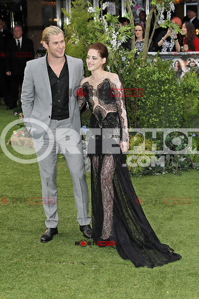 LONDON - MAY 14: Chris Hemsworth; Kristen Stewart attend the World Film Premiere of 'Snow White And The Huntsman' at the Empire Cinema, Leicester Square, London, UK. May 14, 2012. (Photo by Richard Goldschmidt)