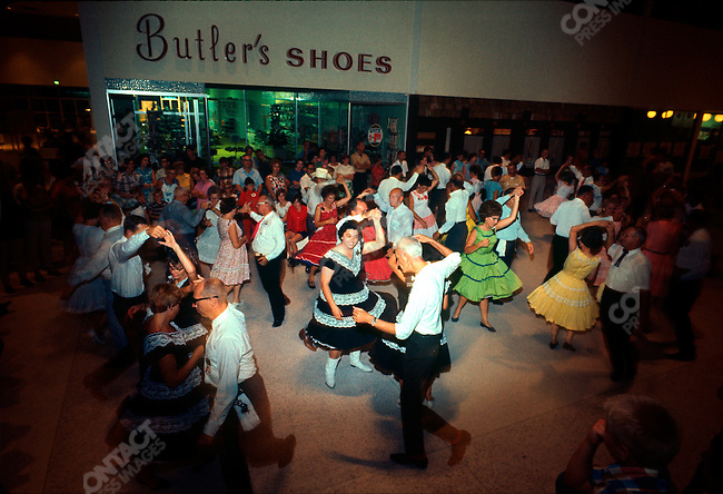Launch of Apollo 11, first manned exploration of the moon. Square dance at a shopping center, night before the launch. Titusvill, Florida, USA, July 15, 1969