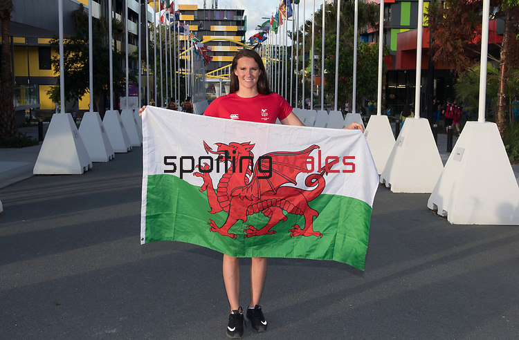 Wales swimmer Jazz Carlin is unvailed as the flag bearer for Wales to lead the team out during the opening ceremony <br />