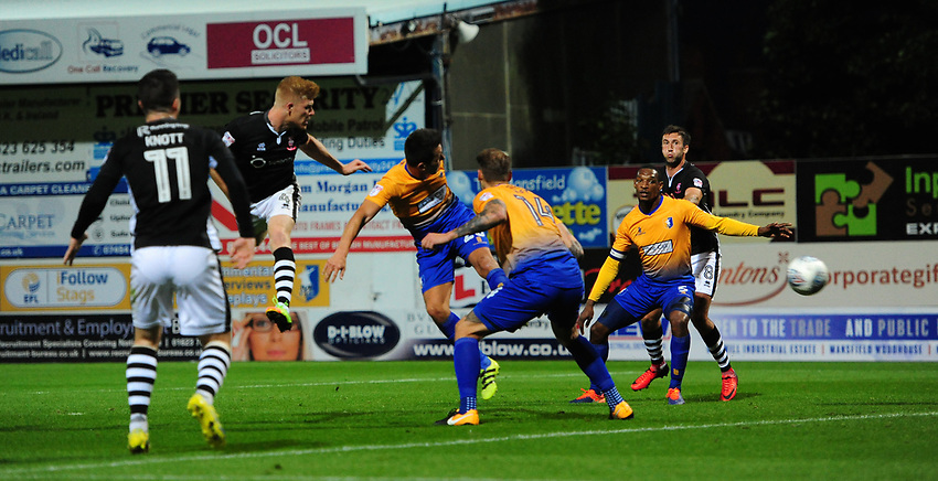 Lincoln City's Elliott Whitehouse, second in from left, scores his sides equalising goal to make the score 1-1<br /> <br /> Photographer Chris Vaughan/CameraSport<br /> <br /> The EFL Checkatrade Trophy - Mansfield Town v Lincoln City - Tuesday 29th August 2017 - Field Mill - Mansfield<br />  <br /> World Copyright &copy; 2018 CameraSport. All rights reserved. 43 Linden Ave. Countesthorpe. Leicester. England. LE8 5PG - Tel: +44 (0) 116 277 4147 - admin@camerasport.com - www.camerasport.com
