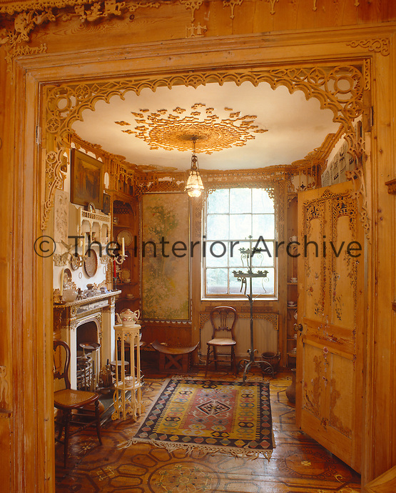 This delicately carved fretwork archway marks the entrance to one of the reception rooms