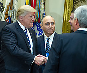 """United States President Donald Trump meets with representatives from PhRMA, the Pharmaceutical Research and Manufacturers of America in the in the Oval Office Roosevelt Room of the White House in Washington, DC on Tuesday, January 31, 2017.  According to its website PhRMA """"represents the country's leading biopharmaceutical researchers and biotechnology companies.""""  President Trump, left, and Joseph Jimenez, CEO, Novartis, center, are pictured as the President greets guests to the meeting.<br /> Credit: Ron Sachs / Pool via CNP"""