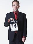 Businessman holding calendar, portrait