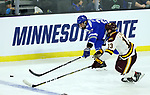 SIOUX FALLS, SD - MARCH 24: Joey Anderson #13 from Minnesota Duluth battles for the loose puck with Erik Baskin #27 from Air Force during their game at the 2018 West Region Men's NCAA DI Hockey Tournament at the Denny Sanford Premier Center in Sioux Falls, SD. (Photo by Dave Eggen/Inertia)