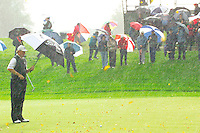THOMASTOWN, IRELAND. Ernie Els of the SA watches his ball roll away from the pin on the 9th with the wind and rain driving down during the American Express Championship day two at the Mount Juliet Golf Club on October 1th, 2004 in Thomastown, Ireland ..Photo AFP/NEWSFILE/FRAN CAFFREY..(Photo credit should read FRAN CAFFREY/NEWSFILE/AFP)...This Picture has been sent you under the condtions enclosed by:.Newsfile Ltd..the Studio,.Millmount Abbey,.Drogheda,.Co Meath..Ireland..Tel: +353(0)41-9871240.Fax: +353(0)41-9871260.GSM: +353(0)86-2500958.email: pictures@newsfile.ie.www.newsfile.ie.FTP: 193.120.102.198..This picture is from Fran Caffrey@newsfile.ie