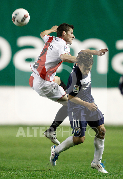 Malaga's Sebastian Fernandez against Rayo Vallecano's Roberto Roman Tito during La Liga Match. October 26, 2011. (ALTERPHOTOS/Alvaro Hernandez)