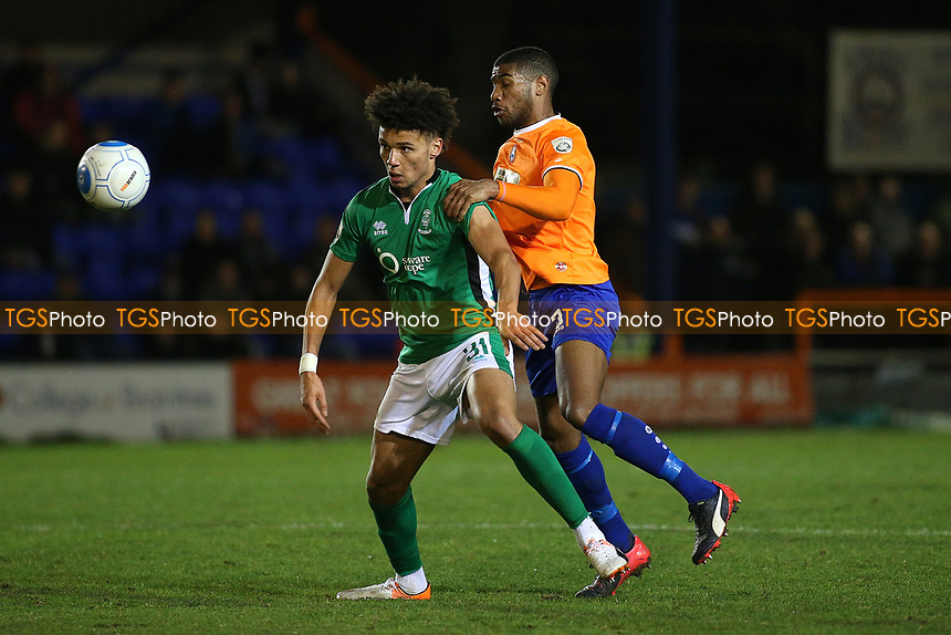 Josh Ginnelly of Lincoln City and Jerome Okimo of Braintree Town during Braintree Town vs Lincoln City, Vanarama National League Football at the IronmongeryDirect Stadium on 7th March 2017