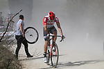 Puncture for Lotto-Soudal on sector 2 Bagnaia during Strade Bianche 2019 running 184km from Siena to Siena, held over the white gravel roads of Tuscany, Italy. 9th March 2019.<br /> Picture: Seamus Yore | Cyclefile<br /> <br /> <br /> All photos usage must carry mandatory copyright credit (© Cyclefile | Seamus Yore)