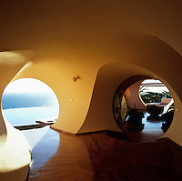 A cave-like ante-room leads from the swimming pool to the main reception room