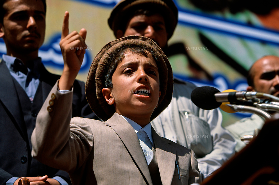 Afghanistan, Kabul, Kabul Stadium, September 9th 2002.<br /> <br /> 1st commemoration of Massoud's death, Achmad Massoud (his son) opens the ceremony with a speech. <br /> <br /> <br /> Afghanistan, Kaboul, Stade de Kaboul, 9 septembre 2002.<br /> <br /> Premiere commemoration de la mort du commandant Massoud, Achmad Massoud (son fils) ouvre la ceremonie avec un discours.