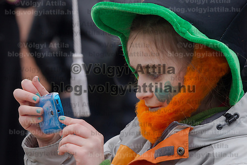 Reveller participates in a Saint Patrick's day celebration march in Budapest, Hungary on March 17, 2013. ATTILA VOLGYI