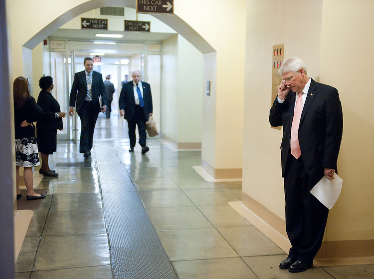 UNITED STATES - JULY 20: Sen. Roger Wicker, R-Miss., talks on his cell phone in the basement of the U.S. Capitol building on Wednesday, July 20, 2011. (Photo By Bill Clark/Roll Call)