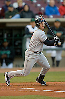 Tony Delmonico #7 of the Great Lakes Loons follows through on his swing versus the Dayton Dragons at Fifth Third Field April 22, 2009 in Dayton, Ohio. (Photo by Brian Westerholt / Four Seam Images)