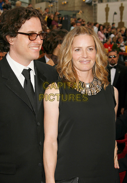 ELISABETH SHUE & GUEST.The 79th Annual Academy Awards - Arrivals held at the Kodak Theatre, Hollywood, California, USA,.February 25th, 2007..oscars red carpet half length black dress elizabeth.CAP/ADM/RE.©Russ Elliot/AdMedia/Capital Pictures...
