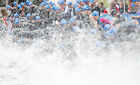 14 AUG 2010 - KITZBUEHEL, AUT - Competitors dive into the water at the start of their wave of the Jedermann Triathlon .(PHOTO (C) NIGEL FARROW)