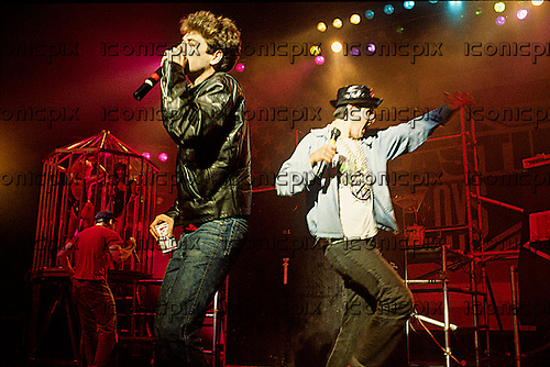 BEASTIE BOYS - L-R: Ad Rock (Adam Horowitz), MCA (Adam Yauch), Mike D (Mike Diamond) - performing live on their first UK Show at the Odeon Hammersmith in London UK - 12 Sep 1986.  Photo credit: PG Brunelli/IconicPix