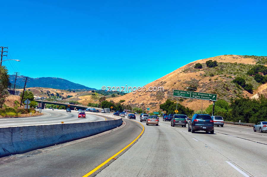 CA-101 Freeway, North,  Lost Hills Rd, Malibu Canyon Exit, limited access, divided highway, with, grade separated, junctions, without traffic lights or stop signs,