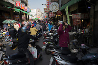 "Motor scooters crowd a street in Tainan, Taiwan, 2015.  Tainan, literally ""Taiwan South"", is a special municipality located in southern Taiwan, facing the Taiwan Strait in the west and south. Tainan is the oldest city in Taiwan and also commonly known as the ""Capital City"" for its over 200 years of history as the capital of Taiwan under Koxinga and later Qing dynasty rule. Tainan's complex history of comebacks, redefinitions and renewals inspired its popular nickname ""the Phoenix City""."