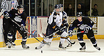 SIOUX FALLS, SD - JANUARY 1: Sam Coatta #9 of the Sioux Falls Stampede along with Ian Young #3 and Jimmy Mullin #21 from the Fargo Force watch the puck bounce away in the first period of their game Saturday night at the Arena. (Photo by Dave Eggen/Inertia)