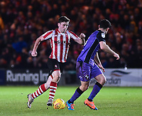 Lincoln City's Shay McCartan runs at Port Vale's Antony Kay<br /> <br /> Photographer Andrew Vaughan/CameraSport<br /> <br /> The EFL Sky Bet League Two - Lincoln City v Port Vale - Tuesday 1st January 2019 - Sincil Bank - Lincoln<br /> <br /> World Copyright © 2019 CameraSport. All rights reserved. 43 Linden Ave. Countesthorpe. Leicester. England. LE8 5PG - Tel: +44 (0) 116 277 4147 - admin@camerasport.com - www.camerasport.com