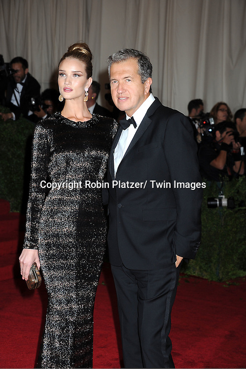 "Rosie Huntington-Whitely and Mario Testino attends the Costume Institute Gala Benefit celebrating ""Schiaparelli and Prada: Impossible Conversations"".an exhibition at the Metropolitan Museum of Art in New York City on May 7, 2012."