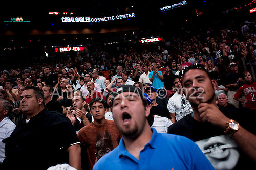 Miami, Florida<br /> January 29, 2012<br /> <br /> The sold-out crowd in the American Airlines Arena is kept on the edge of their seats in the last seconds of the game between the Miami HEAT and the Chicago BULLS. The BULLS close the HEAT's ten point lead and battle for the final score 97 HEAT to 93 BULLS.