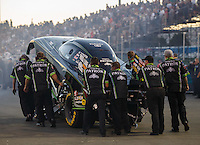 Jul 29, 2016; Sonoma, CA, USA; Crew members push the car of NHRA funny car driver Alexis DeJoria during qualifying for the Sonoma Nationals at Sonoma Raceway. Mandatory Credit: Mark J. Rebilas-USA TODAY Sports