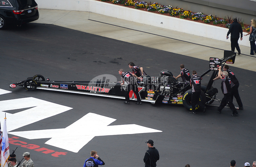 Apr. 15, 2012; Concord, NC, USA: NHRA crew members for top fuel dragster driver Doug Kalitta during eliminations for the Four Wide Nationals at zMax Dragway. Mandatory Credit: Mark J. Rebilas-