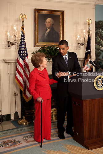 Washington, DC - June 2, 2009 -- Former First Lady Nancy Reagan stands alongside President Barack Obama at the podium as he announces and signs the Ronald Reagan Centennial Commission Act in the Diplomatic Room of the White House, June 2, 2009..Mandatory Credit: Pete Souza - White House via CNP