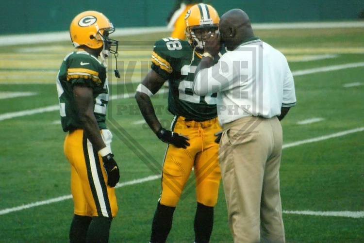 GREEN BAY - September 1999: Demond Parker (22), Basil Mitchell (28) and Harry Sydney of the Green Bay Packers during a game on September 2, 1999 at Lambeau Field in Green Bay, Wisconsin. (Photo by Brad Krause)