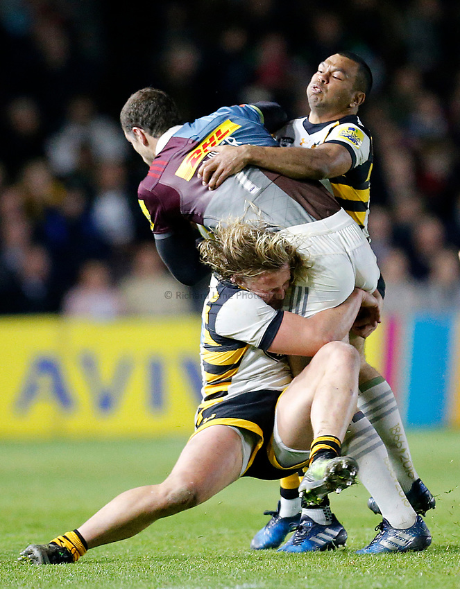 Photo: Richard Lane/Richard Lane Photography. Aviva Premiership. Harlequins v Wasps. 28/04/2017. Wasps' Tommy Taylor and Kurtley Beale tackle Quins' Tim Visser.