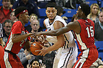 UNLV's Patrick McCaw (2) and Dwayne Morgan (15) pressure Nevada's AJ West (3) during a college basketball game against Nevada in Reno, Nev., on Tuesday, Jan. 27, 2015. The Rebels won 67-62. (Las Vegas Review-Journal/Cathleen Allison)