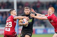 Picture by Allan McKenzie/SWpix.com - 07/04/2018 - Rugby League - Betfred Super League - Salford Red Devils v Warrington Wolves - AJ Bell Stadium, Salford, England - Warrington's Daryl Clark fends off Salford's Josh Wood.
