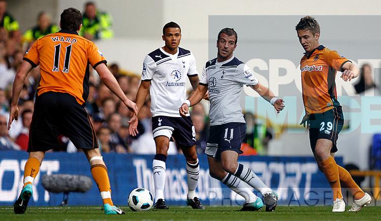 Rafael van der Vaart of Tottenham Hotspur holds off Kevin Doyle of Wolverhampton Wanderers