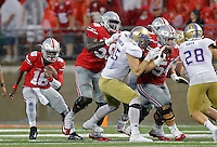 Ohio State Buckeyes quarterback J.T. Barrett (16) runs the ball behind the Ohio State Buckeyes offensive lineman Isaiah Prince (59) and offensive lineman Billy Price (54) in the 4th quarter of their game at Ohio Stadium in Columbus, Ohio on September 10, 2016.  (Kyle Robertson / The Columbus Dispatch)