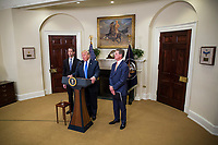 "United States President Donald J. Trump makes an announcement on the introduction of the Reforming American Immigration for a Strong Economy (RAISE) Act in the Roosevelt Room at the White House in Washington, D.C., U.S., on Wednesday, August 2, 2017. The act aims to overhaul U.S. immigration by moving towards a ""merit-based"" system. Pictured at left is US Senator Tom Cotton (Republican from Arkansas). Photo Credit: Zach Gibson/CNP/AdMedia"