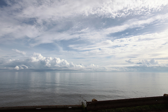 Early morning clouds appear to rest on the Sulu Sea off the coast of Mindanao island, Philippines. June 13, 2011.