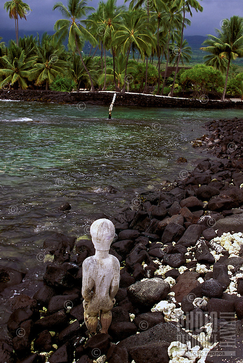 Kii looking out toward Honaunau Bay from Puu Honua O Honaunau National Historic Park (City of Refuge), in Kona, Hawaii.
