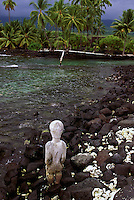 Kii looking out toward Honaunau Bay from Puu Honua O Honaunau National Historic Park (City of Refuge), in Kona, Hawaii.