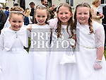 Jucy Stafford Sheeran, Amy O'Rourke, Lily Donnelly and Grace Kelly from St. Joseph's School who received their first holy communion in St. Joseph's church Mell. Photo:Colin Bell/pressphotos.ie