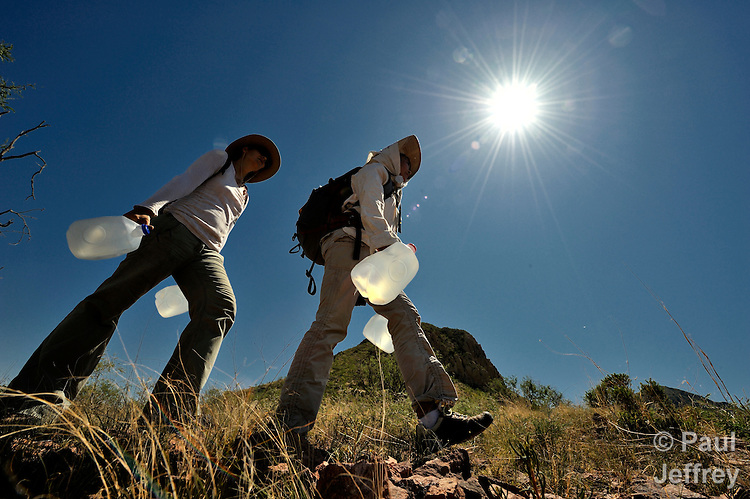 Sarah Parker (left) of Redlands, California, and Ros Ruiz, of Oakland, California, hike through the desert of southern Arizona in order to place water for migrants crossing from Mexico into the United States. They are members of No More Deaths, a group dedicated to stopping the deaths of migrants along the border.