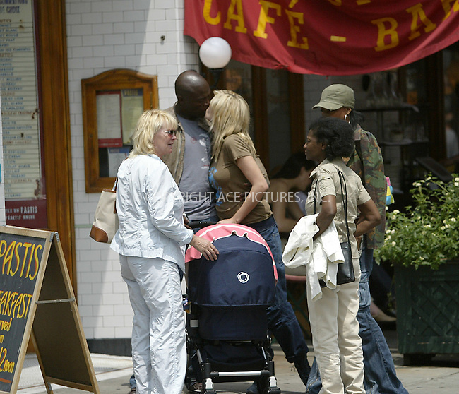 Model Heidi Klum with her mother, baby, Seal and unidentified companions were seen having lunch at Pastis in meat packing district. New York, May 21, 2004. Please byline: ACE Pictures.   .. *** ***  ..All Celebrity Entertainment, Inc:  ..contact: Alecsey Boldeskul (646) 267-6913 ..Philip Vaughan (646) 769-0430..e-mail: info@nyphotopress.com