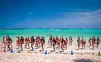 Dominikanische Republik, Punta Cana, Animation, Strandgymnastik am Playa Bavaro   Dominican Republic, Punta Cana, entertainment, gymnastics at beach Playa Bavaro