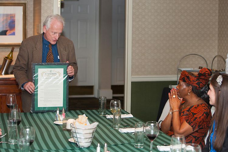 Dr. Herman W. Hill Jr. presents a citation to Beatrice Selotlegeng which was honored by the Cutler Scholar program at Ohio University on April 8, 2014.  Photo by Ohio University / Jonathan Adams