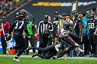 3rd November 2019; Wembley Stadium, London, England; National Football League, Houston Texans versus Jacksonville Jaguars; Tight End Jordan Akins of Houston Texans is tackled by Defensive Back Breon Borders of Jacksonville Jaguars - Editorial Use