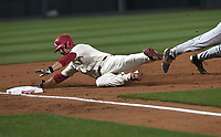 NWA Democrat-Gazette/J.T. WAMPLER  Arkansas' Jordan McFarland slides into third base Tuesday March 13, 2018 against Texas at Baum Stadium in Fayetteville. Arkansas won 13-4.