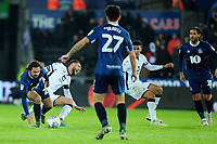 Matt Grimes of Swansea City is fouled by Bradley Dack of Blackburn Rovers leading to his second yellow card during the Sky Bet Championship match between Swansea City and Blackburn Rovers at the Liberty Stadium in Swansea, Wales, UK. Wednesday 11 December 2019